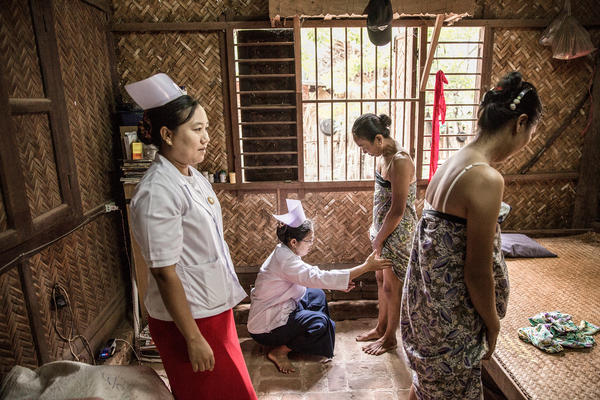 Health care workers screen women for leprosy in Nyaung U, Myanmar. However, there is no simple diagnostic test for leprosy to catch it early.