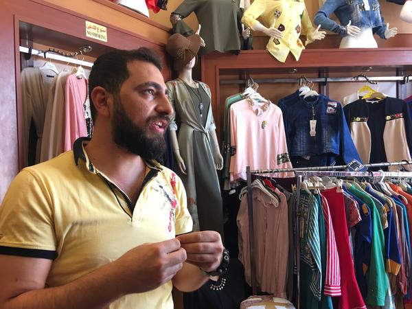 Ahmed Jawdat at his shop in east Mosul. Most of the things Jawdat sells were banned under ISIS. When his shop in west Mosul was destroyed he re-opened on the east side.