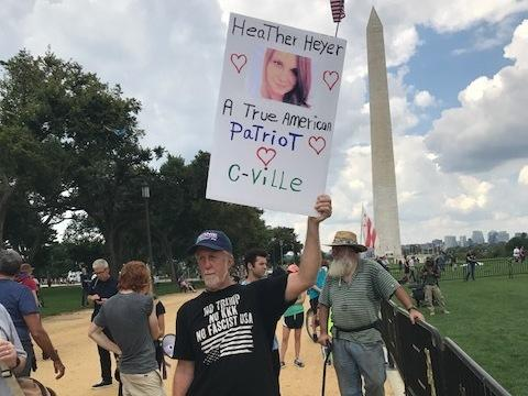 A counterprotester holds a sign remembering Heather Heyer, who died at a white supremacist rally in Charlottesville, Va., last month.