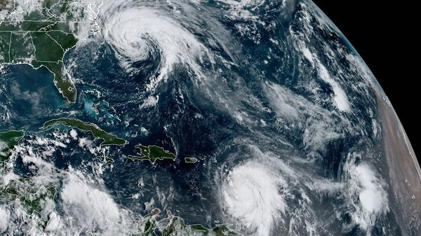 Satellite imagery from NOAA shows Hurricane Jose, along the U.S. East Coast, and Hurricane Maria, in the Atlantic Ocean near the Leeward Islands. Trailing Maria is Tropical Depression Lee.