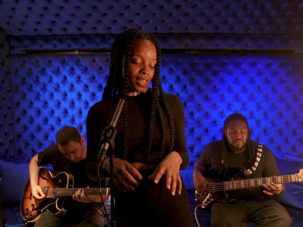 "Jamila Woods sings ""HEAVN"" at PUBLIC ARTS in downtown Manhattan."