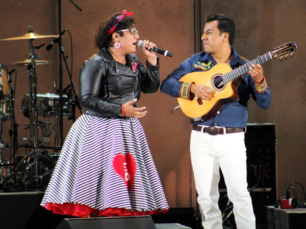 """Vocalist La Marisoul and guitarist Jose """"Pepe"""" Carlos from the band La Santa Cecilia perform at the Hollywood Bowl in Los Angeles"""