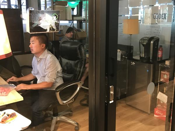 Tan Ly works in a WeWork space in downtown Washington, D.C. WeWork is among several companies that offer workspaces around the world.