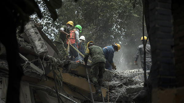 Rescue workers search for earthquake survivors in Mexico City on Wednesday.