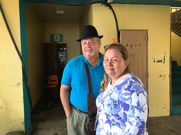 """Irma Rivera Aviles and husband Ivan Martinez's home was severely damaged by Hurricane Maria. The couple are now staying at a shelter, where Rivera Aviles says, """"the situation here is critical."""""""