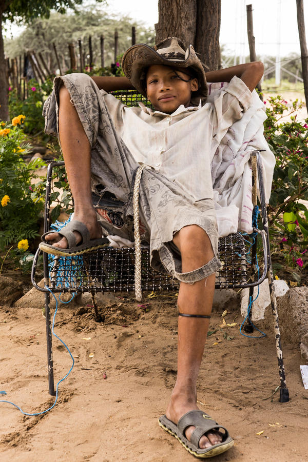 A relaxed moment for a child in the Khoisan hunter-gatherer society.