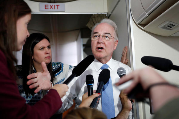 """Secretary of Health and Human Services Tom Price, joined by White House press secretary Sarah Huckabee Sanders, speaks to media aboard Air Force One. Price <a href=""""http://www.politico.com/story/2017/09/27/tom-price-travel-house-oversight-243201"""">has reportedly spent more than $400,000</a> of public money on trips using private aircraft."""