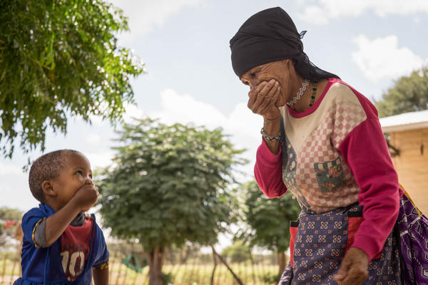 A grandmother and granddaughter in Namibia share a joke. The are members of the Khoisan group.