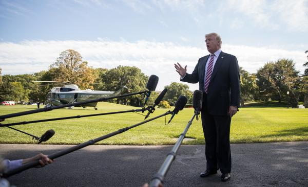 President Trump takes questions from reporters before boarding Marine One on the South Lawn of the White House on Friday.