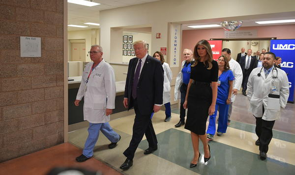 President Trump along with first lady Melania Trump visits the University Medical Center in Las Vegas on Wednesday to meet with medical staff and survivors of the mass shooting in the area.