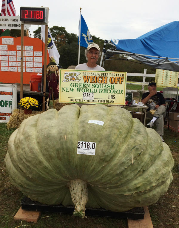 Joe Jutras stands with his world record breaking 2,118-pound squash, following a weigh-in at Frerichs Farm in Warren, R.I.
