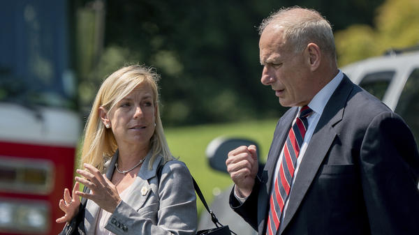 White House Chief of Staff John Kelly and Deputy Chief of Staff Kirstjen Nielsen speak together as they walk across the South Lawn of the White House in August.
