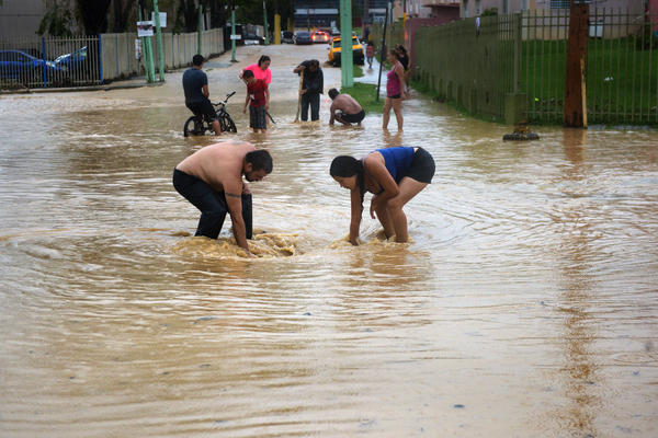 Continued flooding brings more suffering to neighborhoods of Utuado after Hurricane Maria devastated Puerto Rico.