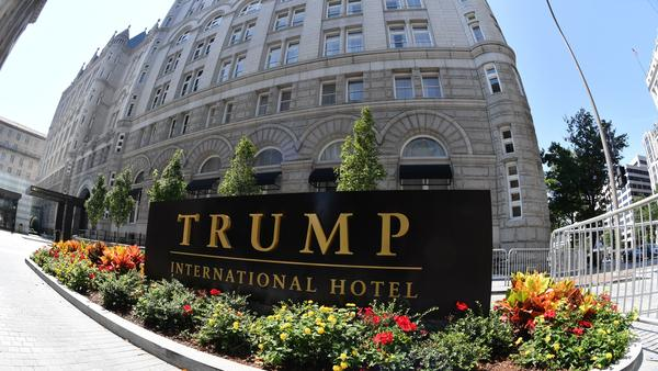 """A lawsuit against President Trump alleges he is violating the Foreign and Domestic Emoluments clauses of the Constitution. Plaintiffs' lawyer Deepak Gupta says Trump's Washington hotel (above) is """"an emoluments magnet."""""""