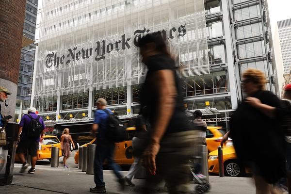 People walk past the New York Times building on July 27, 2017 in New York City. (Spencer Platt/Getty Images)