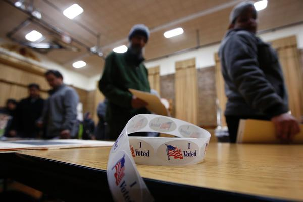 """A roll of """"I Voted"""" stickers sits on a table at an elementary school during the U.S. presidential election on November 8, 2016 in Dearborn, Mich."""