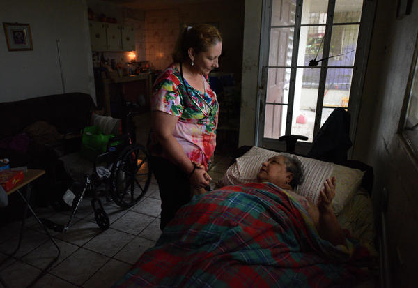 "Rivera, a retired nurse, visits Miriam Negron, who is bedridden. Negron has no power or water and a bedroom that still floods. ""We need to give them some hope,"" said Rivera. ""These are the people who need us."""