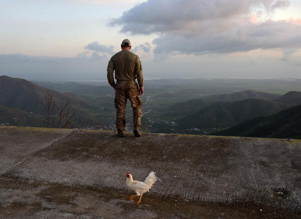 Santini stands at the mountaintop home of John and Margie Caraxini in Aibonito after delivering food and water.