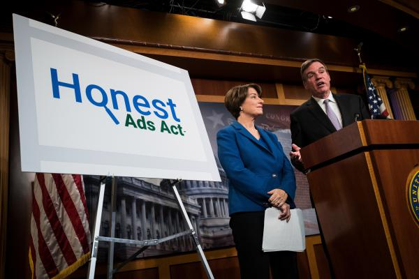 Sen. Amy Klobuchar, D-Minn., (left) and Sen. Mark Warner, D-Va., holds a news conference Oct. 19 to introduce legislation designed to increase the transparency of political ads on Facebook, Twitter and other social media platforms.