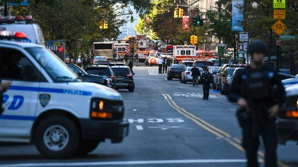 """Police secure the area in Lower Manhattan near where a vehicle drove onto a bicycle path Tuesday afternoon, killing """"several people,"""" according to New York City police."""
