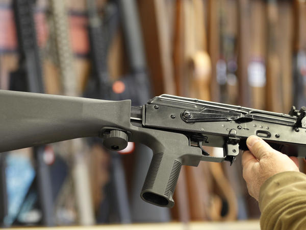 A bump stock device (left) can be fitted to a semi-automatic rifle to increase firing speed.