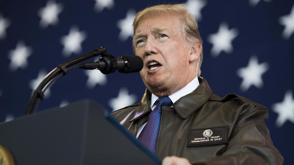 President Trump speaks to service members at Yokota Air Base in Tokyo on Sunday.
