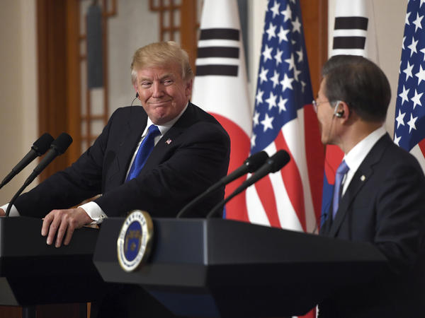 President Donald Trump smiles with South Korean President Moon Jae-in during a joint news conference at the presidential Blue House in Seoul, South Korea, on Tuesday.