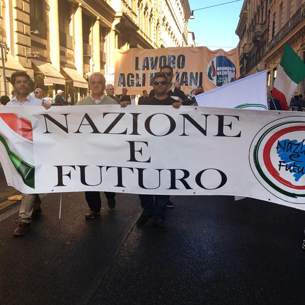 """Italians marching in an anti-migrant rally in Rome hold a banner reading """"Nation and Future."""""""