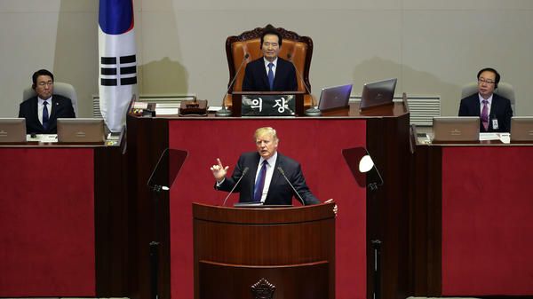 President Trump speaks Wednesday morning at the National Assembly in Seoul, South Korea. He praised the country for its postwar growth and promised to protect it against North Korea.