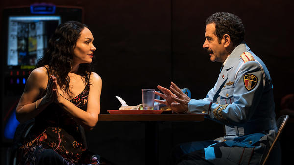 Katrina Lenk's and Tony Shalhoub's characters have an almost-romance in <em>The Band's Visit</em>.