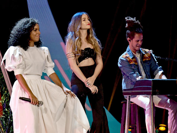 LAS VEGAS, NV - NOVEMBER 16: (L-R) Danay Suarez, Sofia Reyes, and Vicente Garcia perform onstage during The 18th Annual Latin Grammy Awards at MGM Grand Garden Arena  in Las Vegas, Nevada.