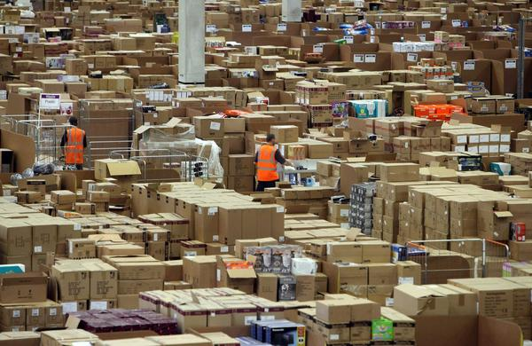 Staff at the Amazon Swansea fulfillment center process orders in November 2010. (Matt Cardy/Getty Images)