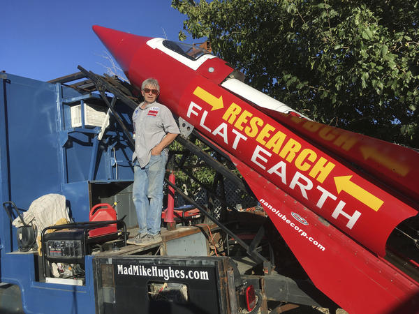 In this photograph taken Nov. 15, Mike Hughes stands beside his steam-powered rocket, which he built from salvaged parts.