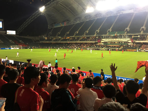 Fans cheer as Hong Kong's soccer team prepares to hit the field. Hong Kong fans have taken to booing China's national anthem in recent years to protest Beijing's tightening grip over the city. China's legislature has now made it illegal to disrespect the national anthem and the law will soon be enacted in Hong Kong.
