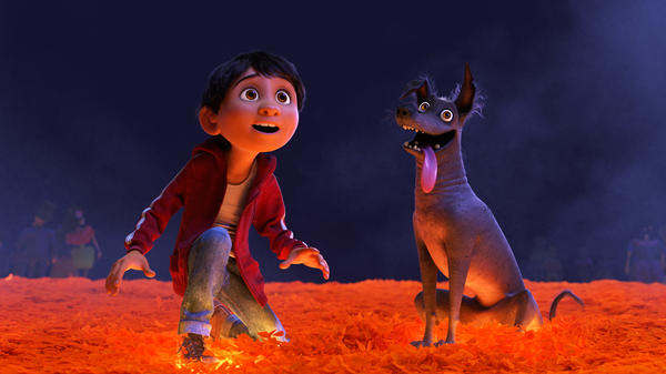 The character Miguel and his canine pal Dante on the Marigold Bridge from the film <em>Coco.</em>