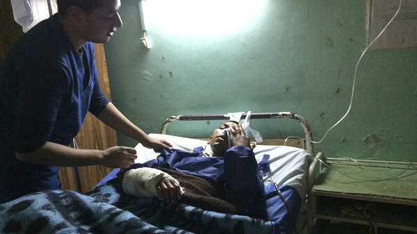 Sulieman Awad receives medical treatment at the Suez Canal University hospital in Ismailia, Egypt, a day after he was injured during an attack on a mosque. Militants attacked a crowded mosque during Friday prayers in the Sinai Peninsula, setting off explosives, spraying worshippers with gunfire and killing more than 300 people.