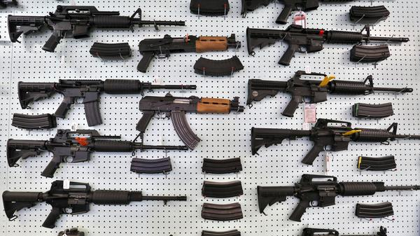 Guns are displayed at Dragonman's, an arms seller east of Colorado Springs, Colo.