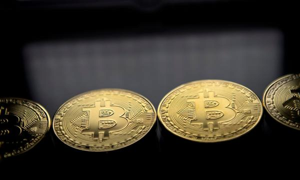 Gold-plated souvenir Bitcoin coins are arranged for a photograph on Nov. 20, 2017. (Justin Tallis/AFP/Getty Images)