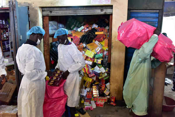 Employees from Ivory Coast's health ministry raid a shop selling counterfeit drugs at the Adjame market in Abidjan earlier this year.
