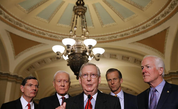 Senate Majority Leader Mitch McConnell, R-Ky. (center), gathered the support he needed on Friday to pass the GOP tax bill in the Senate. Now that legislation must be reconciled with the House version.