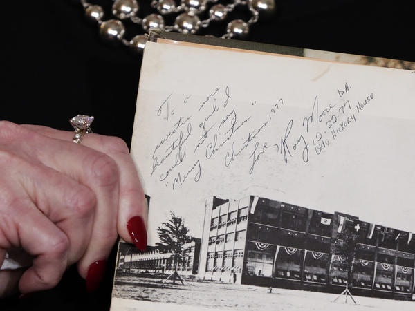 Nelson, one of several accusers of Alabama Republican Roy Moore, shows her high school yearbook she alleges was signed by Moore, at a news conference last month.