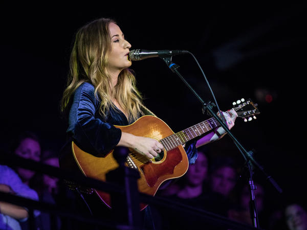 Margo Price serenades the audience from the 9:30 Club balcony at NPR Music's 10th Anniversary Concert.