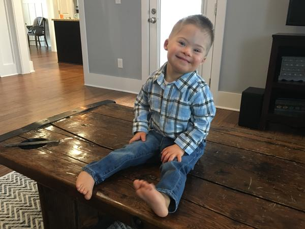 """Kelly Kuhns's 2-year-old son Oliver was born with Down syndrome. She says that she was shocked when a prenatal test revealed a Trisomy 21 mutation. But, she says, """"he's still a baby. He's still worthy of a life just like everybody else."""""""