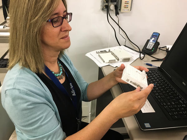 Mine Cicek, an assistant professor at the Mayo Clinic, processes samples for the All of Us program.