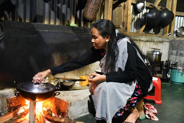 """Hosana Mawroh, 47, started her own restaurant three years ago. She says the arrival of tourists """"has uplifted us — we send our children to better schools in the capital, wear better clothes, and eat better food."""" Our life is changed """"since we were put on the map,"""" she says. But it is still a lot of hard of work to keep the village clean, she adds."""