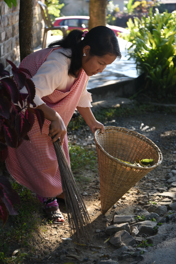 Resident Shidamon Kharrymba has help put Mawlynnong on the map as part of a team of women the village council has employed to clean up the common areas of the village each day. She carries the wicker dustbin that has become the emblem of Mawlynnong. Tourists snap up miniature versions of the baskets for mementos.