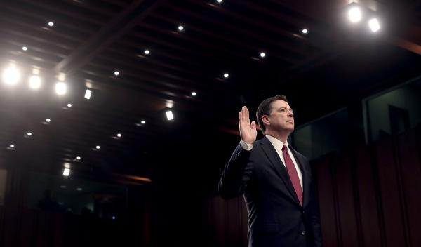 Former FBI Director James Comey is sworn-in before testifying before the Senate Intelligence Committee on Capitol Hill on June 8.