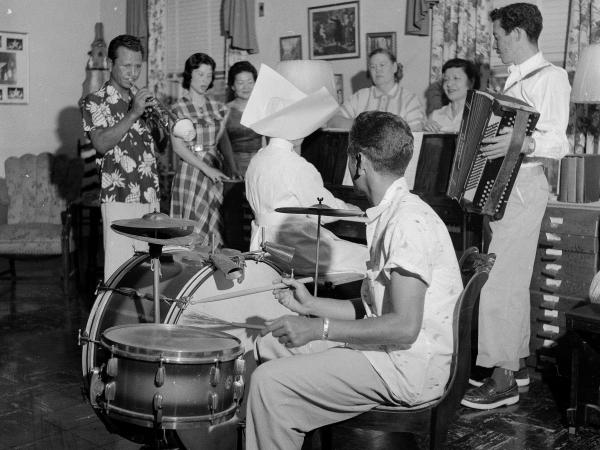 Patients at the Carville, La. hospital enjoying a musical evening around 1955.