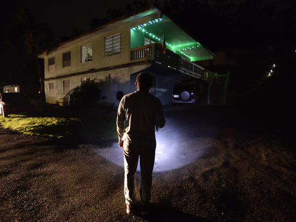 Jose Luis Gonzalez of Morovis illuminates his path with a lantern on a street of the Barrio Patrón.