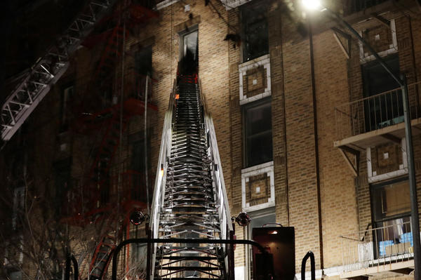 At least 12 were killed in the fire in the five-story building.